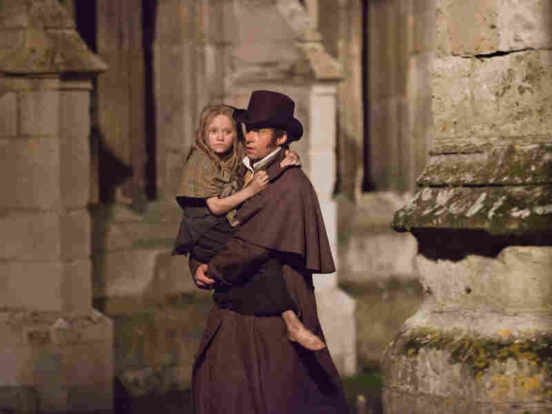 Jean Valjean and young Cosette (Isabelle Allen), two of the most iconic characters in contemporary musical theater, come to the big screen.