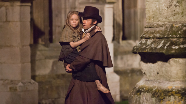 Jean Valjean and young Cosette (Isabelle Allen), two of the most iconic characters in contemporary musical theater, come to the big screen. (Universal Pictures)