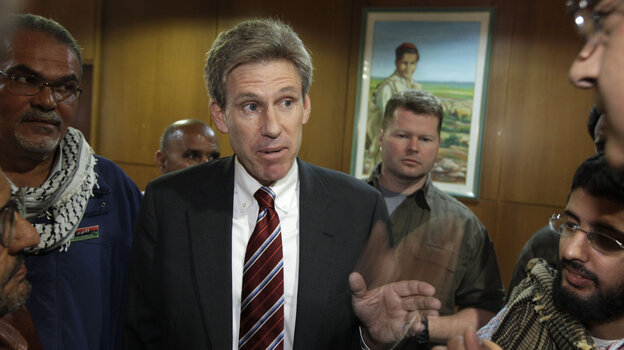 Chris Stevens speaks to the media in Benghazi, Libya, in 2011. Stevens, the U.S. ambassador to Libya, was killed on Sept. 11 of this year. Three U.S. government officials resigned Wednesday following a report that cited inadequate security.