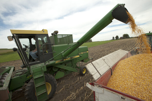 Farmer Randy Dreher unloads corn from his combine during harvest north of Audubon, Iowa. Farm exports are booming and high global prices are he