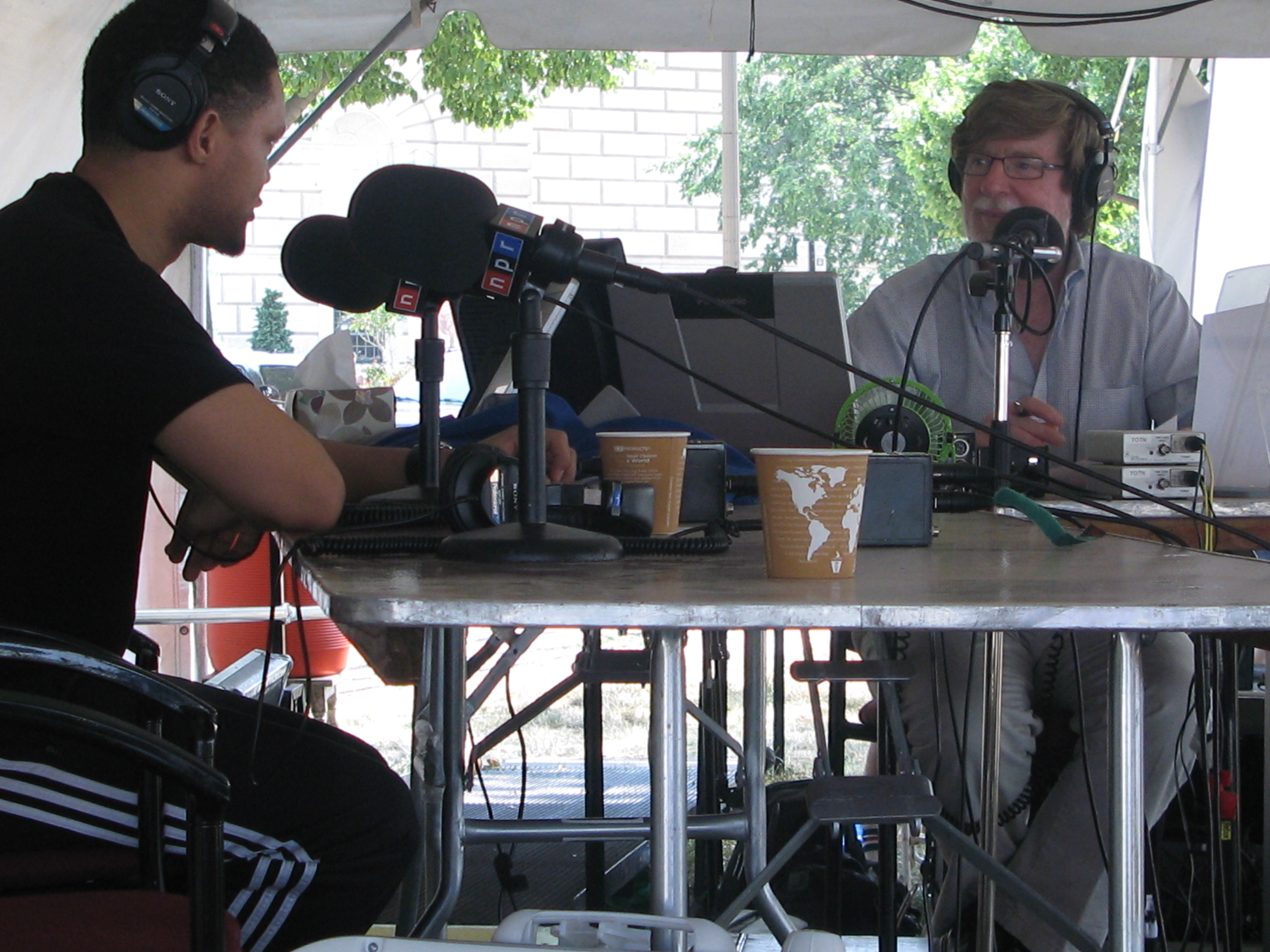 Host Neal Conan chats with comedian Trevor Noah during Talk of the Nation's live broadcast at the Smithsonian Folklife Festival.