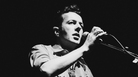 Joe Strummer performs with his solo project, The Latino Rockabilly War, in 1989. The Clash frontman died of heart failure in December 2002.