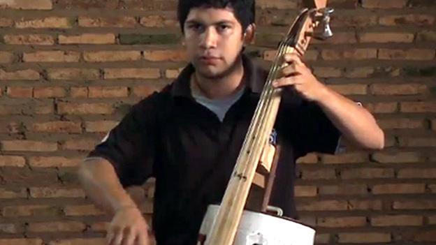 Cellist Juan Manuel Chavez, whose instrument is made from an oil can and discarded bits of wood. (Landfill Harmonic)