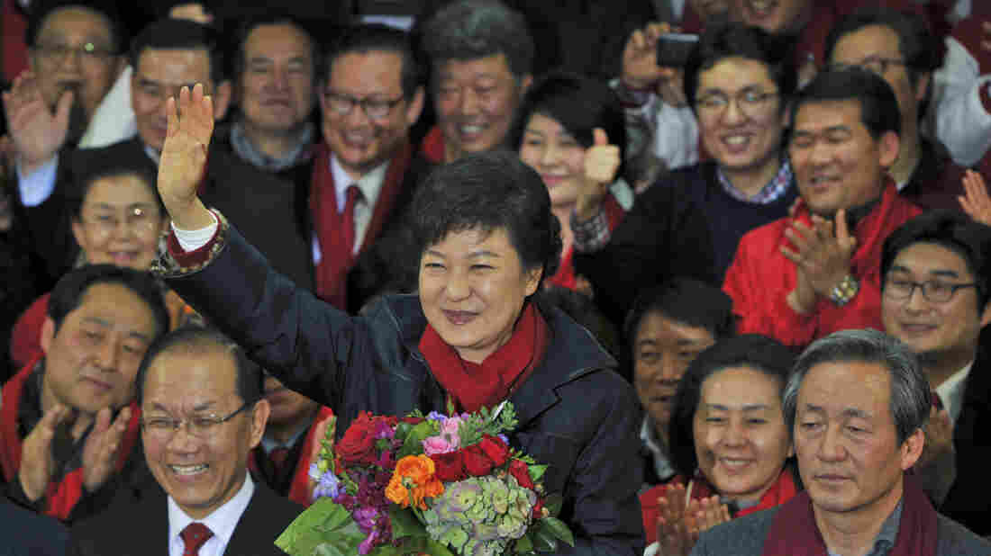 South Korea's Park Geun-hye claimed victory Wednesday in the country's presidential election. Park, the daughter of a former military dictator, will be the first female leader of the country. Here, she greets supporters at party headquarters.