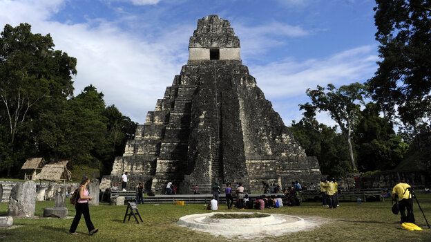 """Tourists are seen in front of the """"Gran Jaguar"""" Mayan temple at the Tikal archaeological site in Guatemala, where ceremonies will be held to celebrate the end of the Mayan cycle known as Baktun 13 and the start of the new Maya Era on December 21."""