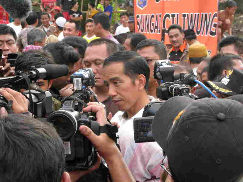 Jakarta Governor Joko Widodo fields reporters' questions after meeting with residents of a Jakarta slum. Recent polls say Widodo is currently the most popular choice for Indonesia's president in 2014.
