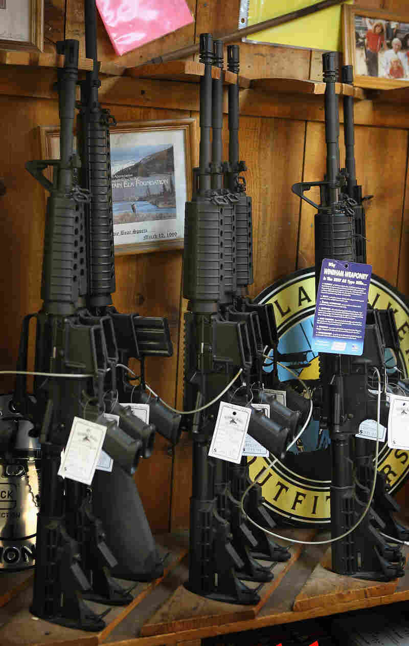 AR-15-style rifles are offered for sale at a sporting goods store in Tinley Park, Ill.