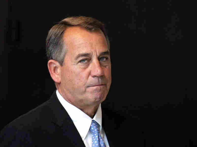 House Speaker John Boehner (R-OH) arrives on Capitol Hill Thursday. The House has postponed an expected vote on the tax portion of the fiscal cliff cuts.