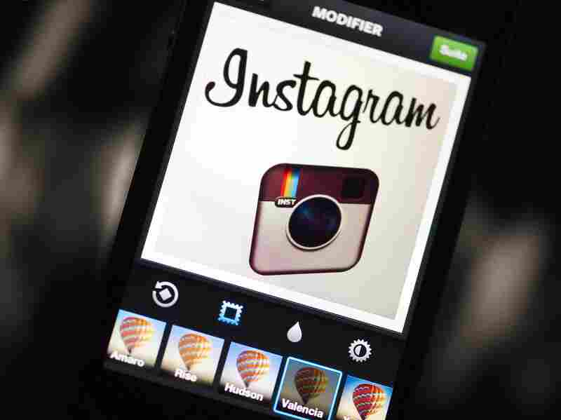 Instagram backed down from a planned policy change that appeared to clear the way for the mobile photo sharing service to sell pictures without compensation, after users cried foul.
