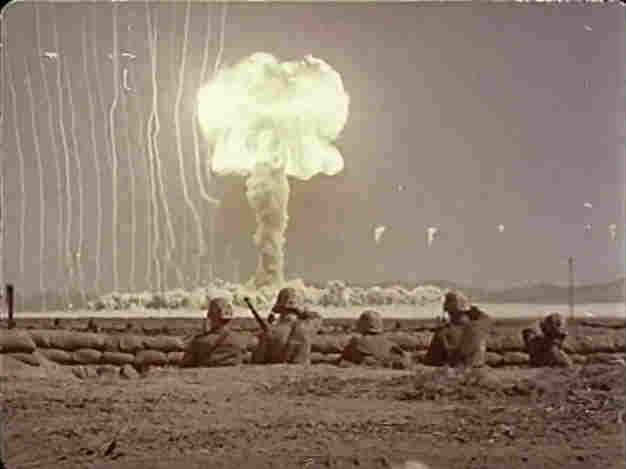 A bomb blast with soldiers