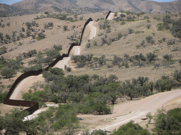A hilltop view of the 18-foot fence along the U.S.-Mexico border west of Nogales, Ariz.