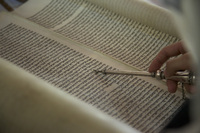 A metallic yad, or hand in Hebrew, is used while worshippers read from the Torah in Bello's synagogue.