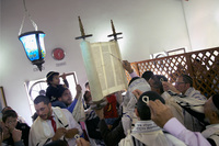 The congregation gathers around the Torah.