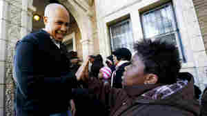 Newark Mayor Cory Booker greets a 13-year-old at a relief center for those affected by Superstorm Sandy, in November.
