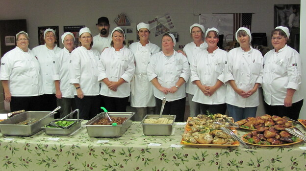 Kathy Del Tonto (far right) participates in a class that teaches school cafeteria workers how to prepare meals from scratch. (LiveWell Colorado)