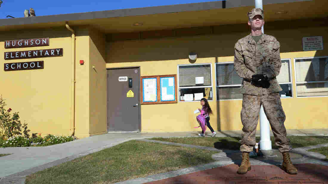 U.S. Marine Corps Reserve Sgt. Craig Pusley stood guard Wednesday at Hughson Elementary School in Modesto, Calif.