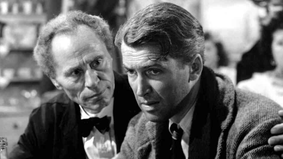 When life gets him down, George Bailey (James Stewart) escapes to Giuseppe Martini's (William Edmunds) neighborhood bar.