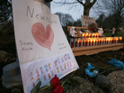 A sign stands at a makeshift memorial in Newtown, Conn., on Dec. 16.