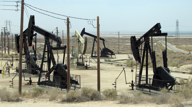 Most hydraulic fracturing in California is done to extract to oil in areas like this field in Kern County. The state is drafting fracking regulations for the first time. (KQED)