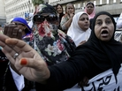 Pakistani health workers demonstrate against the slayings of their colleagues on Wednesday Dec. 19, 2012.