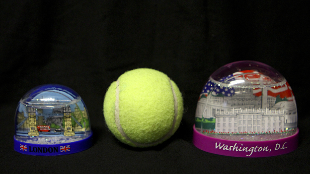 One of these snow globes doesn't belong onboard. The one on the left, which is about the size of a tennis ball, is permitted in your carry-on luggage. The one on the right is not. (NPR)