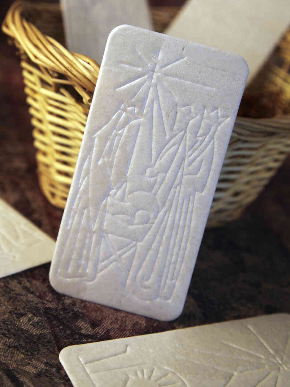 The oplatek, embossed with a Christmas scene, is shared among family members before Christmas Eve dinner.