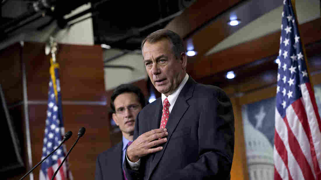 "House Speaker John Boehner, R-Ohio, joined by House Majority Leader Eric Cantor, R-Va., speaks to reporters about the ""fiscal cliff"" negotiations at the Capitol on Friday."