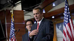 """House Speaker John Boehner, R-Ohio, joined by House Majority Leader Eric Cantor, R-Va., speaks to reporters about the """"fiscal cliff"""" negotiations at the Capitol on Friday."""