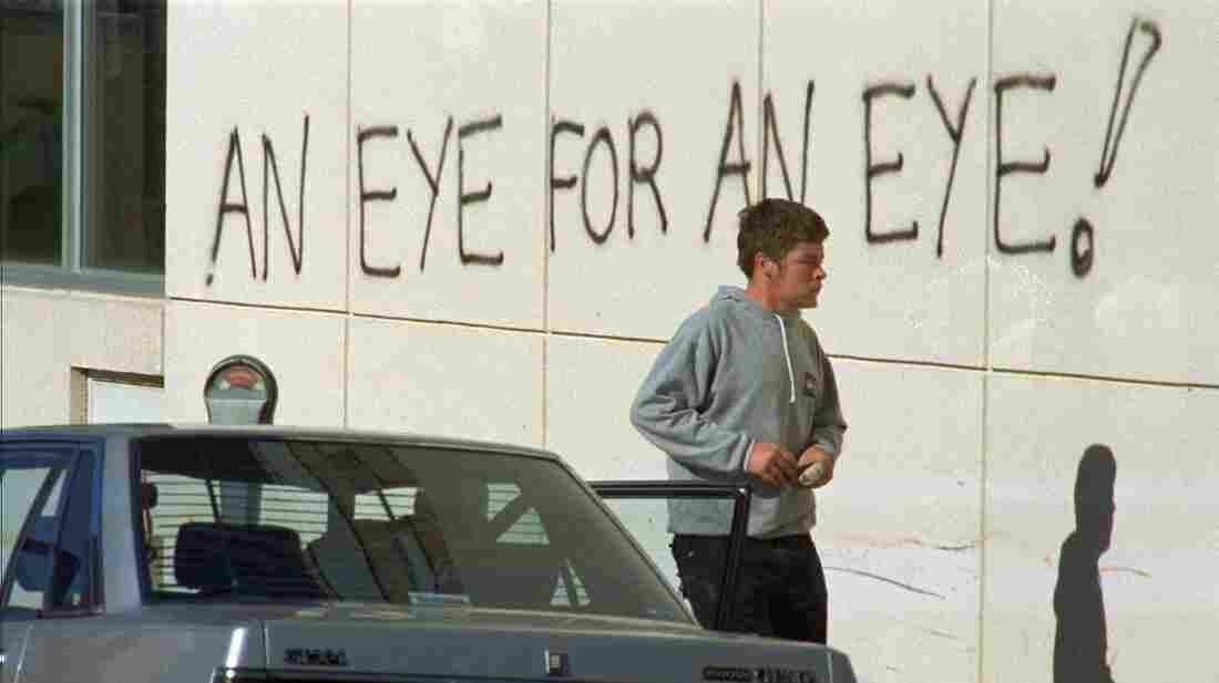 After a 1996 mass killing, Australia tightened its gun laws. Here, graffiti covers the wall of the hospital holding the suspect of the massacre that left 35 people dead.