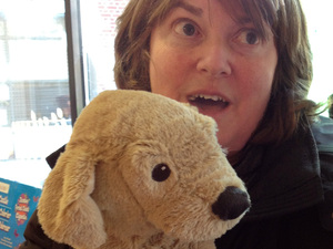 """""""I got this stuffed puppy, that's just such a love,"""" says toy shop visitor Eileen Pepel, whose extended family lost several homes on Staten Island in Hurricane Sandy."""