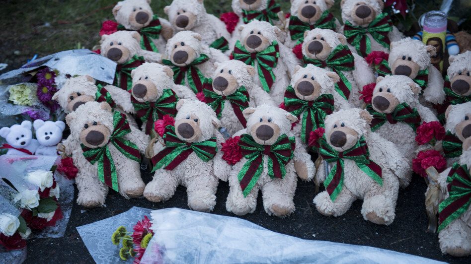 Stuffed animals and flowers at a makeshift memorial near the entrance to the grounds of Sandy Hook Elementary School. (AFP/Getty Images)