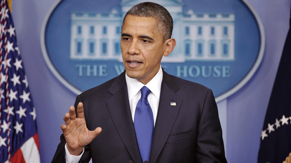 At a press conference Friday, President Obama urges  Congress to pass a scaled-back package to avert end-of-year tax hikes and spending cuts. (AFP/Getty Images)