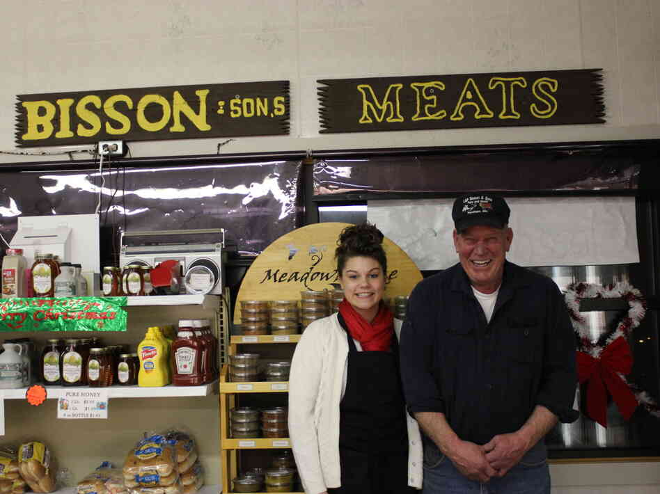 Robert Bisson of Bisson and Sons Meat Market in Topsham, Maine, with his granddaughter. The butcher shop sells traditional cretons during the holidays.