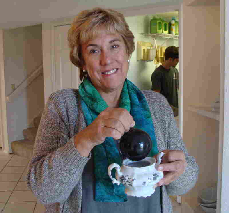 Janet Wilson salvaged a few things from the ashes of her former house, including her mother's sugar bowl and a single, fire-scorched Christmas ornament.