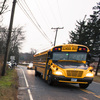 A school bus drives past a welcome sign near the Chalk Hill Middle School in Monroe, Conn. Students from Sandy Hook Elementary in neighboring Newtown will attend the school in January.