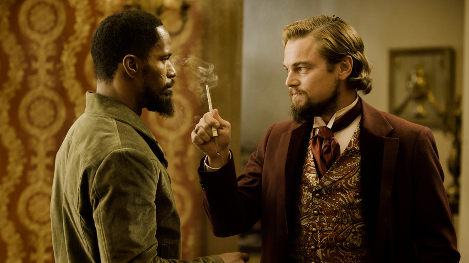 Django confronts Calvin Candie (Leonardo DiCaprio), the man who owns his wife. (The Weinstein Co.)