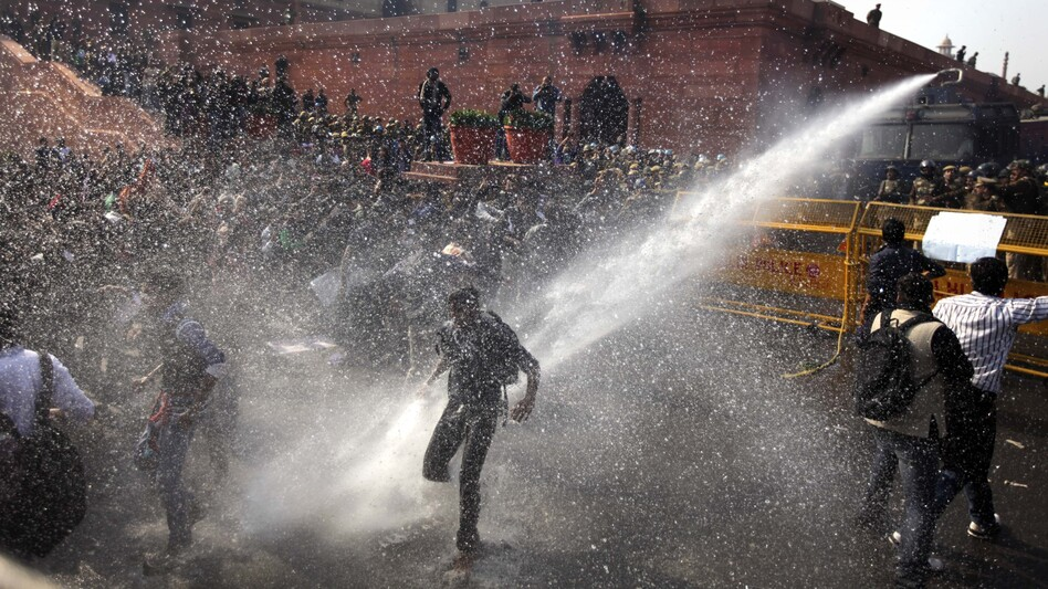 A water cannon targets protesters during their march toward the presidential palace in New Delhi on Saturday. (AP)
