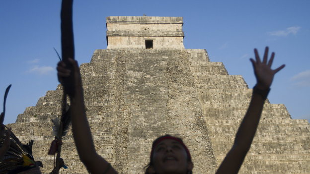 Visitors at the Chichen Itza archaeological park in Yucatan state, Mexico, celebrate the end of the Mayan calendar cycle. Even a failed apocalypse has value, in reminding us that life is fragile and unpredictable. (AFP/Getty Images)