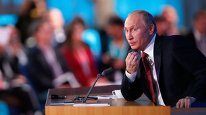 Russian President Vladimir Putin speaks during a news conference in Moscow on Thursday. Putin has voiced support for a measure that would ban U.S. adoptions of Russian children.