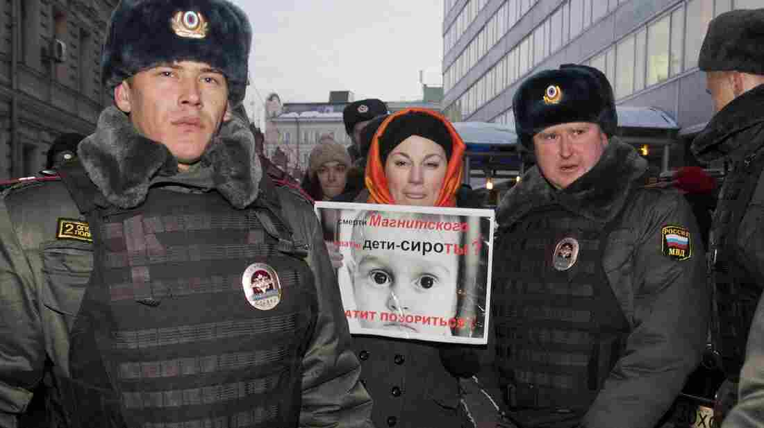 Police officers detain a protester outside the lower house of Russia's parliament on Wednesday. This week, Russian legislators passed a bill banning Americans from adopting Russian children after the U.S. passed a law that rebukes Russia for human rights abuses.