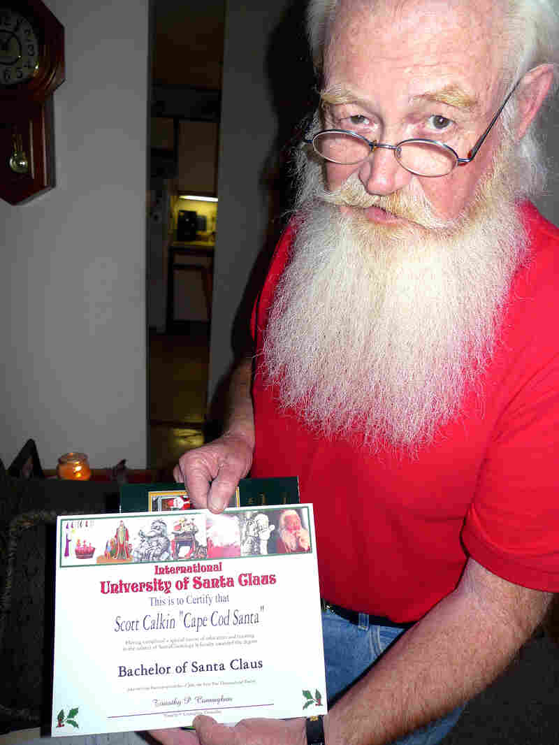 Scott Calkin, aka Cape Cod Santa, shows his diploma from the International University of Santa Claus.