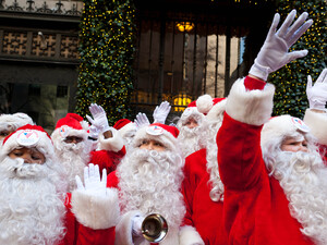 Charity workers dressed as Santa Claus wave to pedestrians in New York. Professional Santas say it's not an easy job, and it's not just as simple as putting on a beard.
