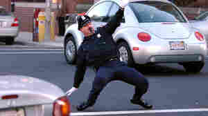 Retired police officer Tony Lepore performs his dance routine while directing traffic in 2004 in downtown Providence, R.I.