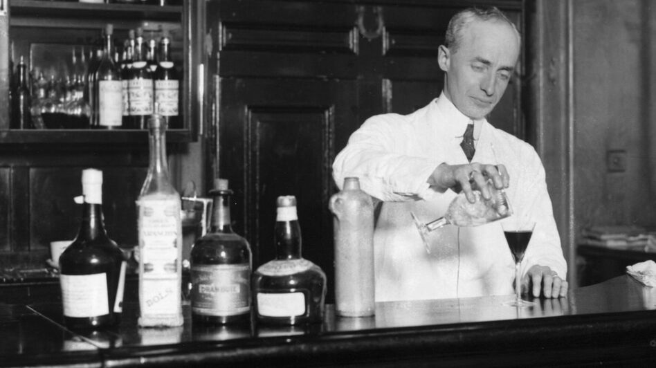 American bartender Harry Craddock mixes a drink at the Savoy Hotel in London in  1926. Craddock is known for helping to popularize the Corpse Reviver, one of the drinks featured in historian Lesley Blume's book about vintage cocktail culture. (Getty Images)