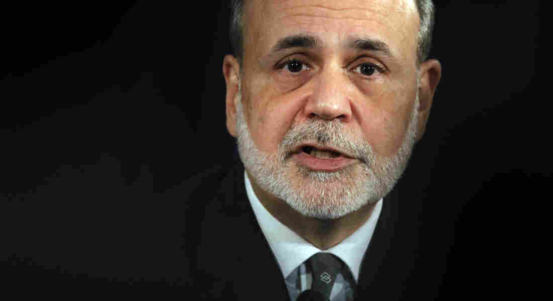 Federal Reserve Chairman Ben Bernanke speaks during a news conference in Washington on Dec. 12. Some economists worry the Fed has set the stage for inflation as well as stock and housing bubbles by keeping interest rates low.