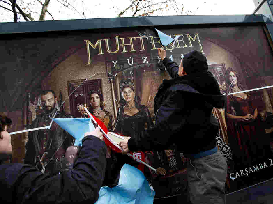 Demonstrators attack a billboard advertising the TV series The Magnificent Century during a protest in Istanbul on Jan. 9, 2011.