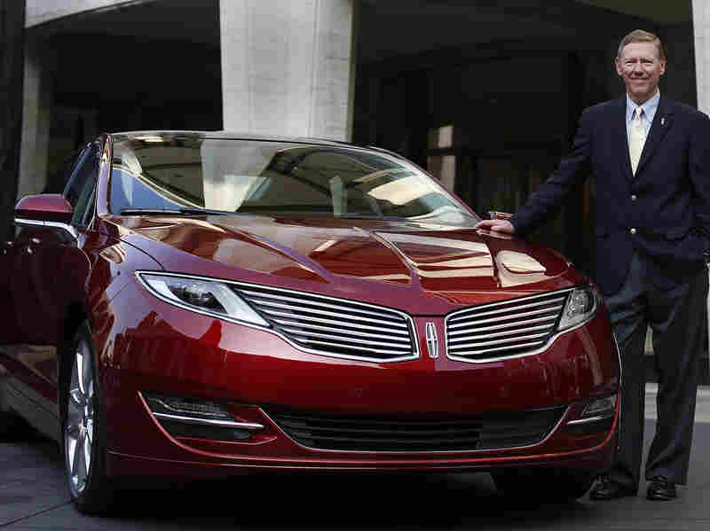 Alan Mulally, president and CEO of Ford Motor Co., stands next to the Lincoln MKZ. For the first time ever, Ford will promote the Lincoln brand during the Super Bowl.