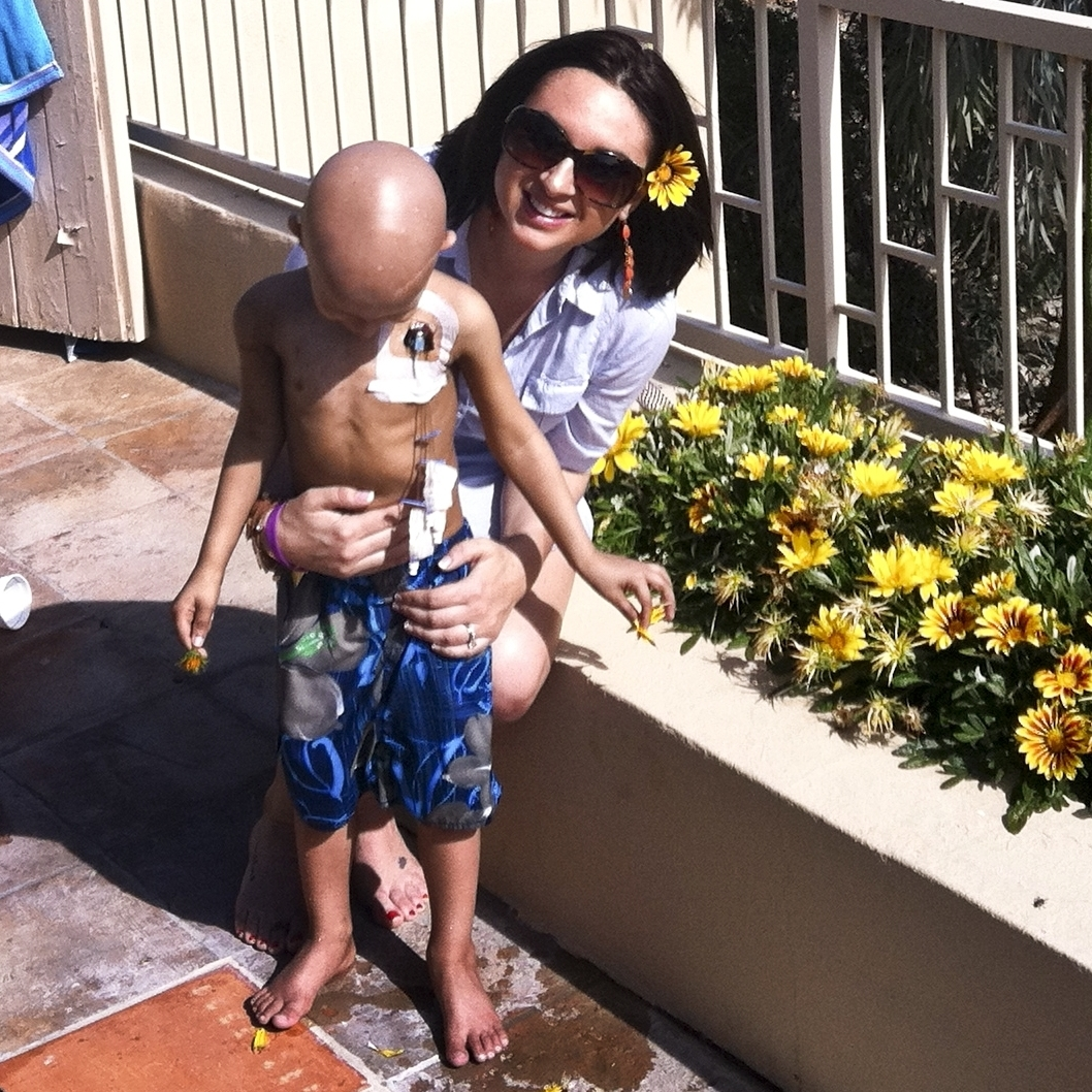 Maya Thompson with Ronan just a few weeks before his death in May 2011. A broviac on his chest administered chemotherapy, platelets and red blood cells when needed. He wanted to play in the hot tub that day, so Maya let him go in up to his midsection to keep the broviac dry.