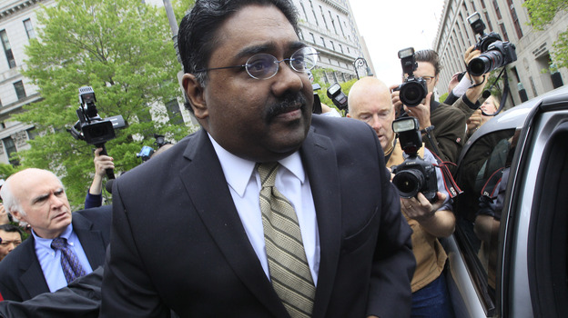 Raj Rajaratnam, center, billionaire co-founder of Galleon Group, is surrounded by photographers as leaves Manhattan federal court May 11 after being convicted of insider trading charges. (AP)
