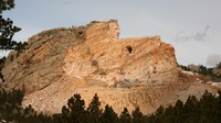 The Crazy Horse monument in March 2012. When finished, it is expected to be 641 feet long and 563 feet high. It is the largest mountain carving in progress.